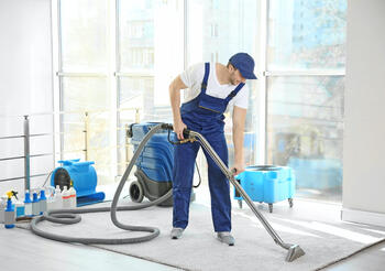 employee cleaning carpet